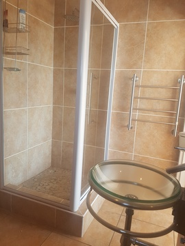 Shower and basin in en-suite bathroom